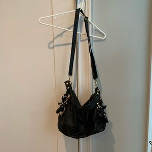 Black oversized slouchy purse with gold hardware